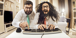 bigstock-Two-weird-computer-geeks-havin-113068865